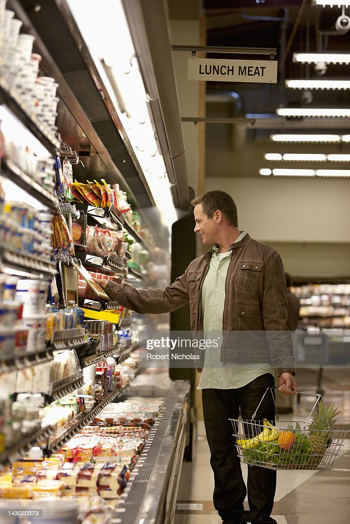 Man shopping in supermarket : Stock Photo