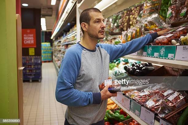 Man shopping in supermarket