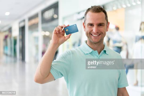Man shopping with a credit card at the mall