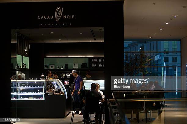 A man shops at a Cacau Noir chocolate shop at the Village Mall shopping center in the Barra da Tijca neighborhood of Rio de Janeiro Brazil on Friday...