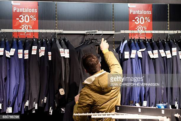 A man shops at a mall in Talange eastern France on the first day of the regional winter sales on January 2 a week ahead of the start of the national...