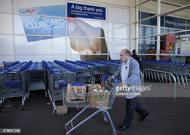 A man shops at a Tesco supermarket in Sunbury west of London on April 22 2015 Britain's biggest retailer supermarket group Tesco announced Wednesday...