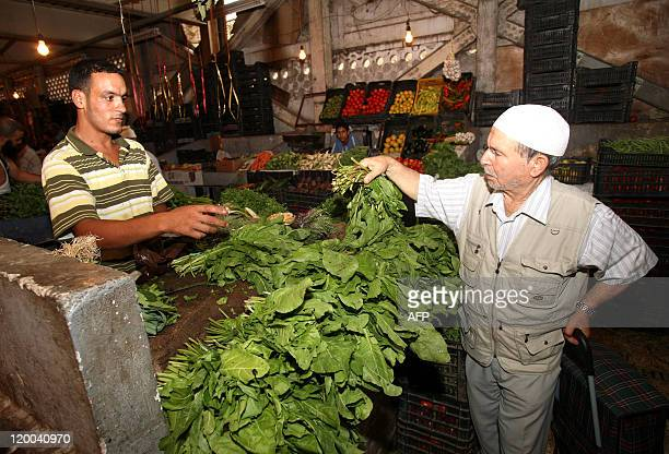 A man shops at Ali Mellah market in Algiers on July 29 2011 Faced with crumbling regimes across the Arab world Algeria has dramatically boosted its...