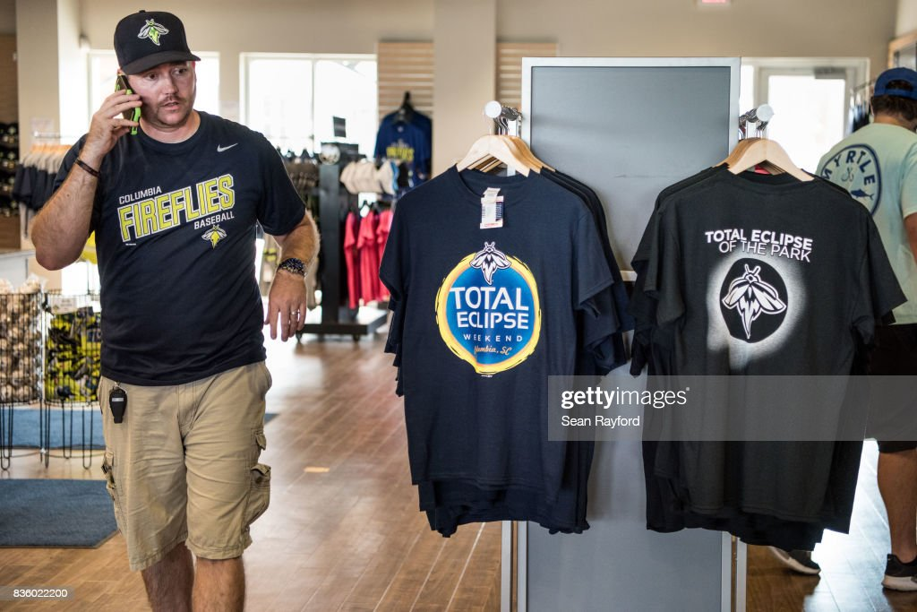 A man shops for eclipse themed t-shirts at Spirit Communications Park August 20, 2017 in Columbia, South Carolina. Columbia is one of the prime destinations for viewing Monday's solar eclipse and NASA expects clear weather would bring over a million visitors to the state.