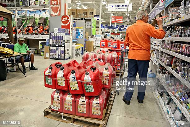 A man shops for lightbulbs amid the gas cans on Tuesday Oct 4 2016 at Lowe's in Oakland Park Fla