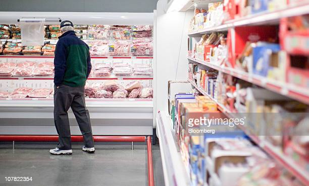 A man shops in the meat department inside a BJ's Wholesale Club store in Falls Church Virginia US on Thursday Dec 30 2010 BJ's Wholesale Club Inc...
