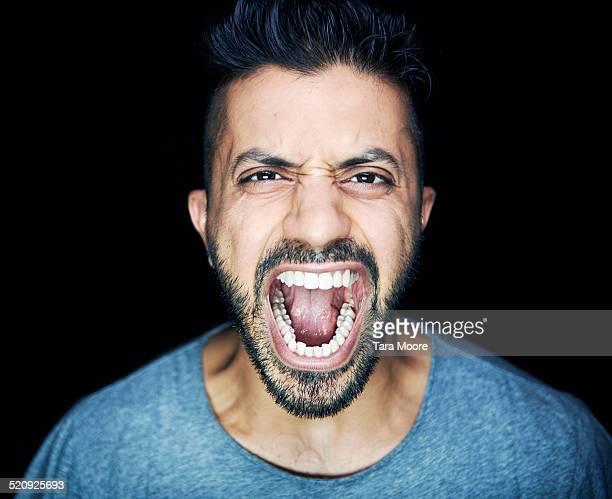 man shouting to camera