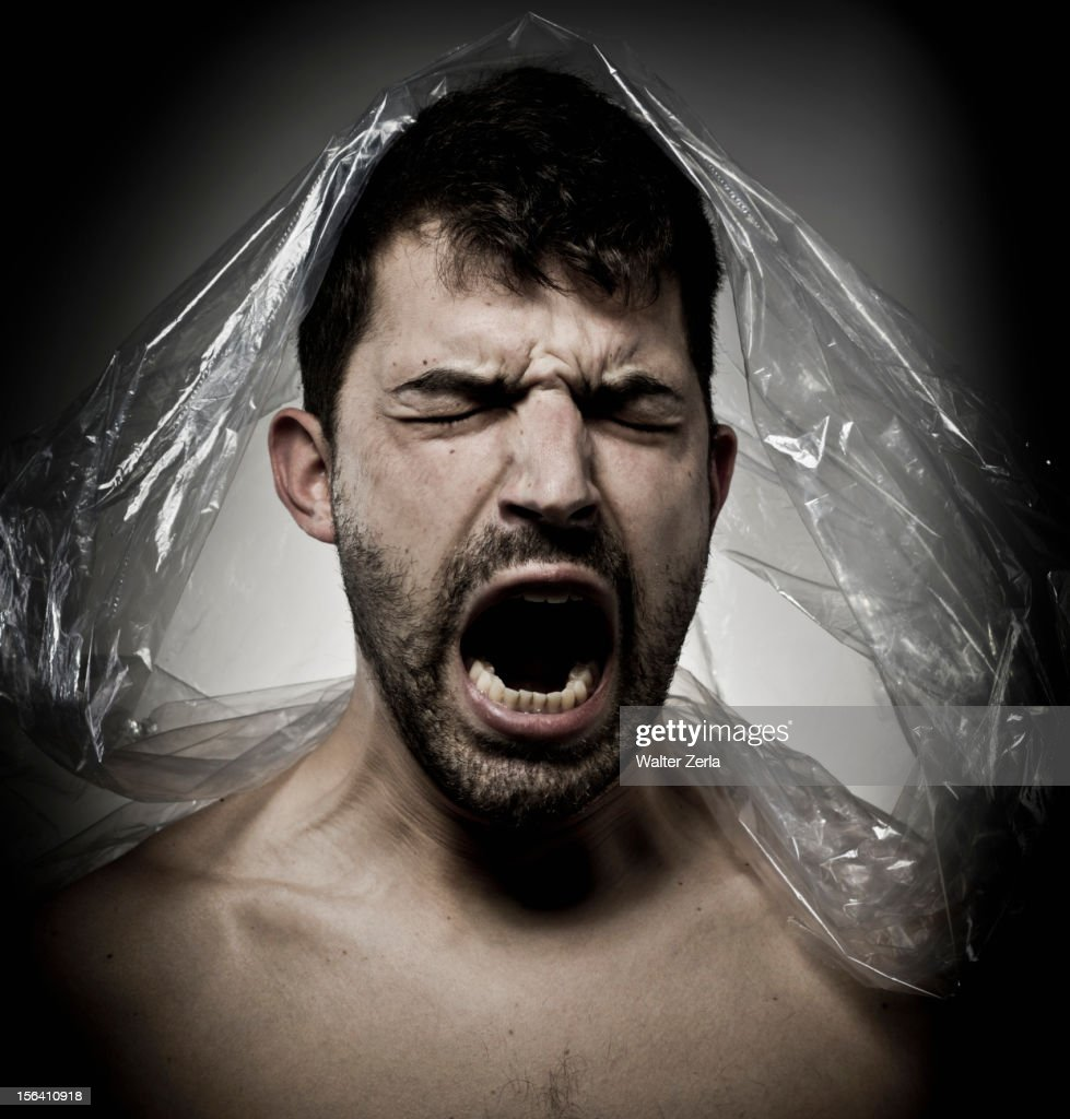 Man shouting with plastic on his head : Stock Photo