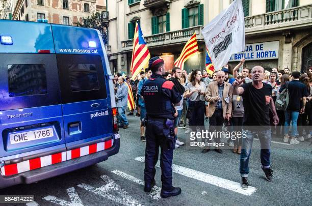 A man shouts against the national police in front of the central Spanish police in Via Laietana About 450000 people have been focused to support the...