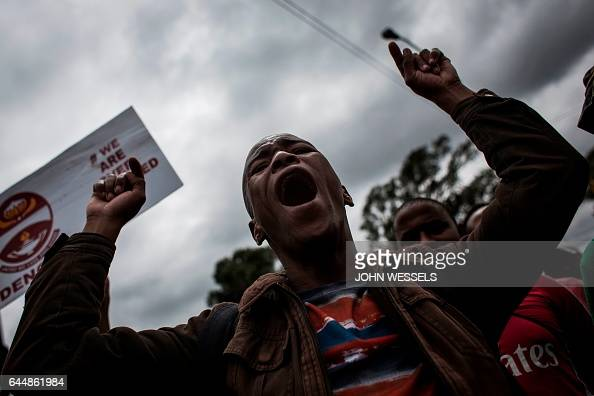 TOPSHOT A man shouts and gestures as he takes part in an antiimmigrant march on February 24 2017 in Pretoria West South African police fired rubber...