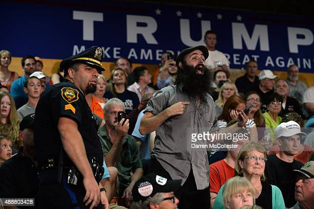 A man shouts during Republican Presidential candidate Donald Trump's town hall event at Rochester Recreational Arena September 17 2015 in Rochester...