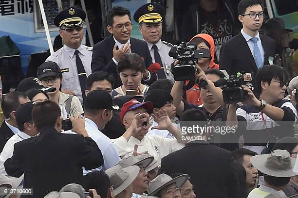 A man shouts 'long live the Republic of China' in reference to Taiwan's official name during National Day celebrations in front of the Presidential...