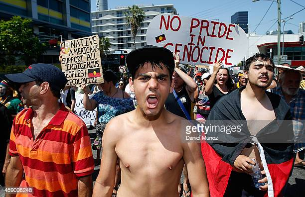 A man shouts slogans about aboriginal rights in Australia during a protest against G20 leaders on November 15 2014 in Brisbane Australia World...