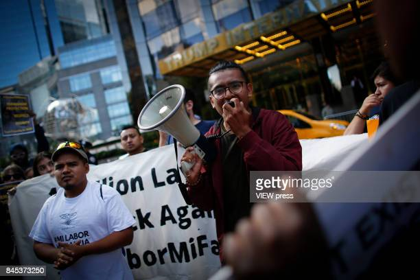 A man shouts slogans as he takes part during a march in protest of President Trump's decision on DACA in front of a Trump Hotel on September 9 2017...