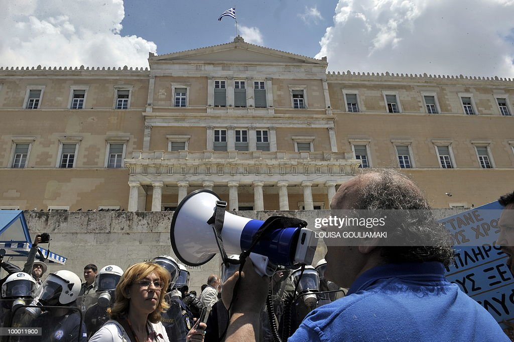 A man shouts slogans in front of the Greek Parliament during the protest march marking the 24-hour general strike against the austerity measures on May 20, 2010. Thousands of protesters took to the streets of Athens and second city Thessaloniki on Thursday in a new general strike against the government's debt-dictated austerity spending cuts and pension reform. AFP PHOTO / Louisa Gouliamaki