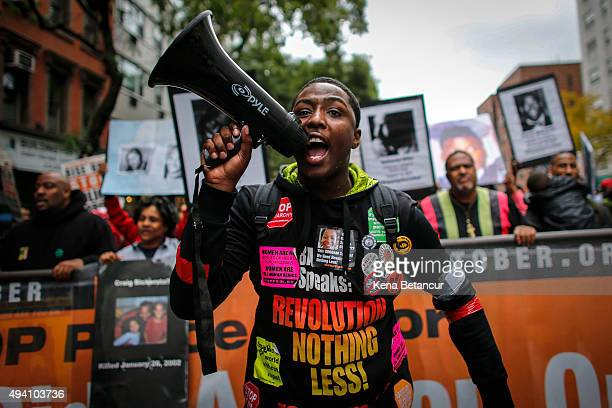 A man shouts slogans in to a bullhorn as he attends a protest to denounce police brutality in Manhattan October 24 2015 in New York City The rally is...