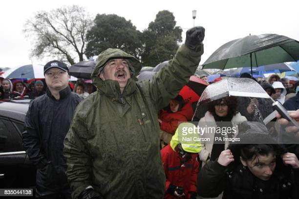 A man shouts slogans of support for the workers and former employees at Waterford Crystal who spent the night occupying the main visitor centre at...