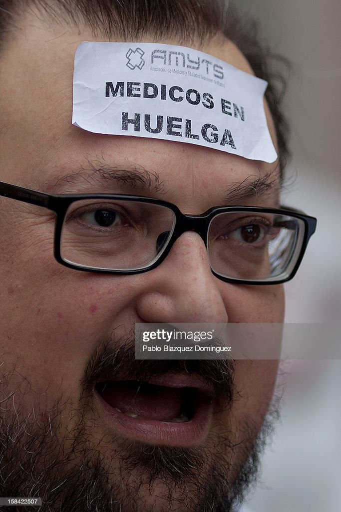 A man shouts slogans wearing a sticker that reads 'Doctor on strike' amid other health workers during a demonstration against cuts on public health care and the privatization of medical centers and hospitals on December 16, 2012 in Madrid, Spain. In Madrid, doctors have already staged 11 days of strikes and all health workers unions are calling for a third 48 hour strike on December 19 and December 20. Around 4,000 operations have been suspended in Madrid since the medical strikes started.