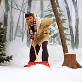 Man shoveling snow with aching back