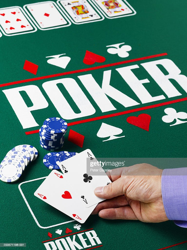 Man showing cards at poker table, close-up of hand : Stock Photo