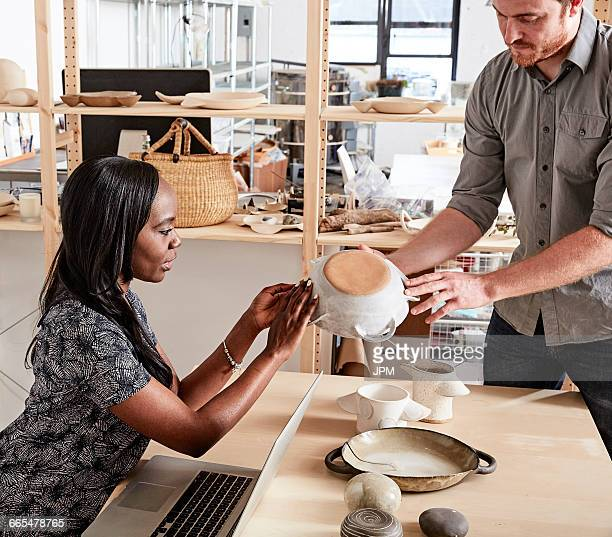 Man showing colleague ceramic samples
