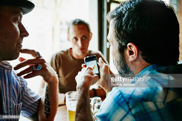 Man showing friend map on smartphone