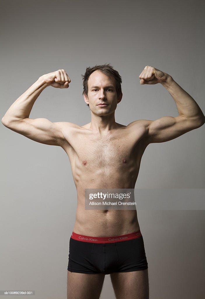 Man showing muscles, portrait : Stock Photo