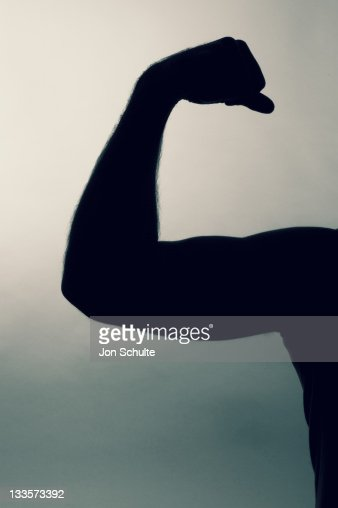 Man showing of biceps. : Stock Photo