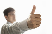Man showing us thumb up gesture