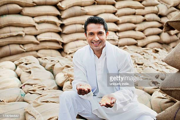 Man showing wheat grains, Anaj Mandi, Sohna, Gurgaon, Haryana, India