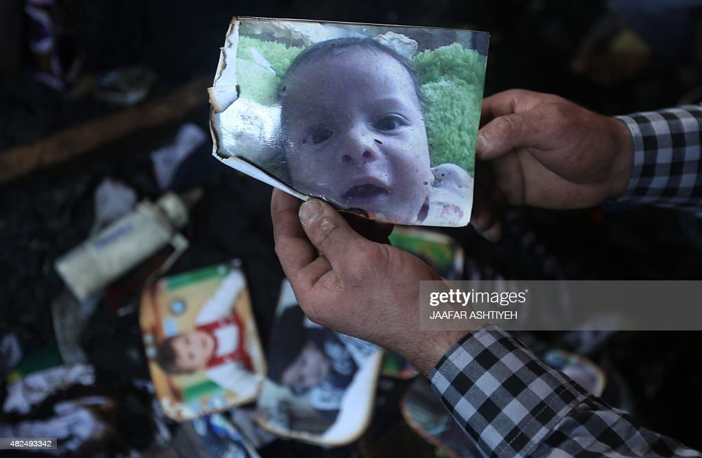 A man shows a picture of 18monthold Palestinian toddler Ali Saad Dawabsha who died when his family house was set on fire by Jewish settlers in the...