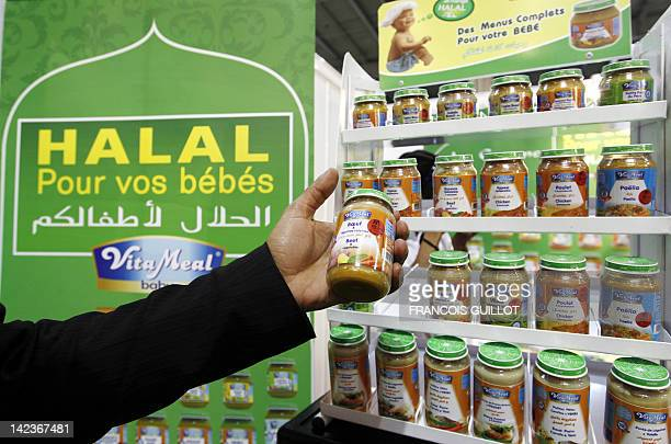 A man shows halal product for babies at a stand of Halal food products on April 3 2012 during the 9th International Halal and oriental products trade...