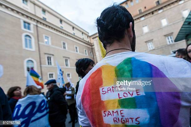 A man shows his back with colorful painted slogans as he joins the rally in support of Gay Civil Union Bill in Rome Supporters of samesex civil...