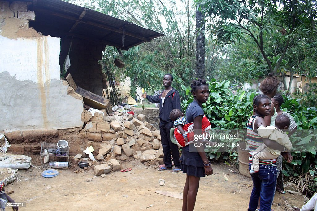 A man shows his house partially destroyed during a flood caused by torrential rains, on December 11, 2012 in Brazzaville. At least 13 people died in the Republic of Congo and two dozen others were injured after this flood caused homes to collapse in southern Brazzaville over the weekend, authorities said on December 10.