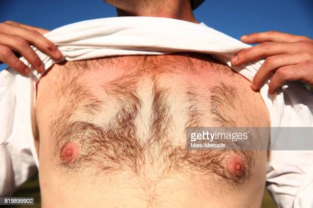 A man shows his shaved Splendour In The Grass chest hair logo during Splendour in the Grass 2017 on July 21 2017 in Byron Bay Australia