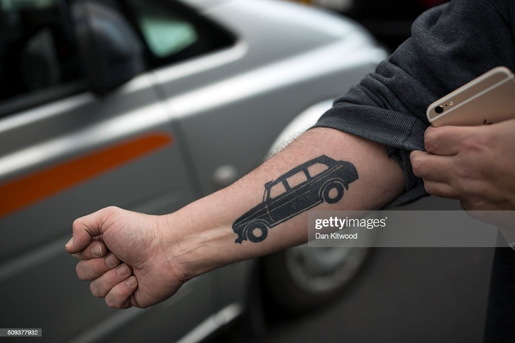 A man shows his tattoo of a London black cab as London taxi drivers stage a protest on Whitehall on February 10, 2016 in London, England. Drivers are claiming that Uber is not subjected to the same stringent regulation requirements as they are and that deregulation of the trade has compromised passenger safety.