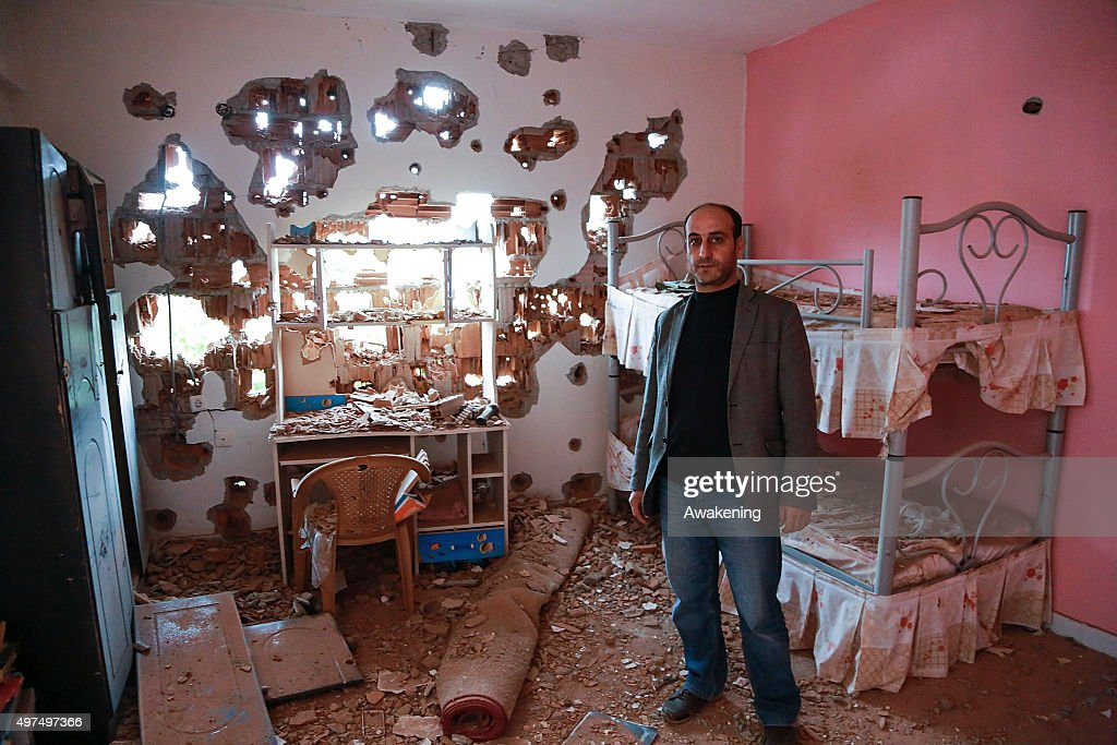 A man shows kids bedroom inside his house that was severely damaged by security operations during the curfew on November 17 2015 in Silvan Turkey The...
