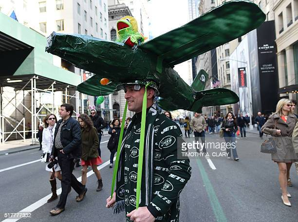 A man shows off his Easter finery as he walks down Fifth Avenue in New York during the annual Easter Parade and Easter Bonnet Festival March 27 2016...