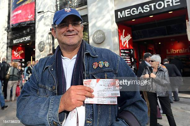 A man shows on October 25 2012 in Paris tickets for a concert held the same day in the French capital by British rock legends The Rolling Stones The...