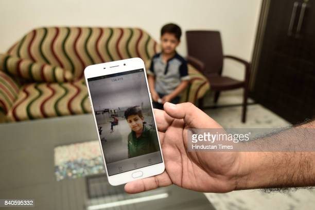 A man shows the photograph of his 14yearold son who died of Dengue last year on August 29 2017 in New Delhi India As per the report released by three...