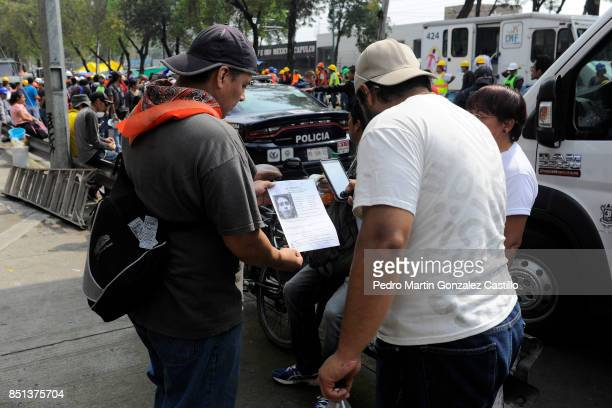 A man shows the picture of a missing family member two days after the magnitude 71 earthquake jolted central Mexico killing more than 250 hundred...