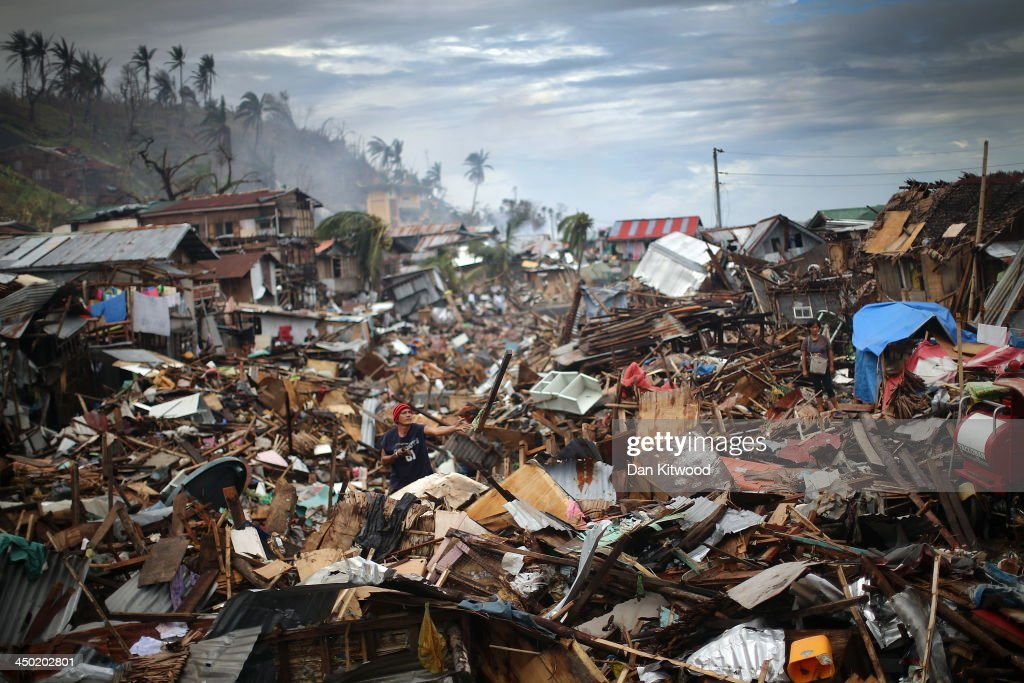 A man sifts through debris in what was a river running through central Tacloban on November 17 2013 in Leyte Philippines Typhoon Haiyan which ripped...