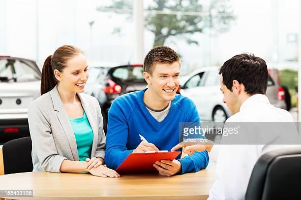 Man Signing Car Agreement