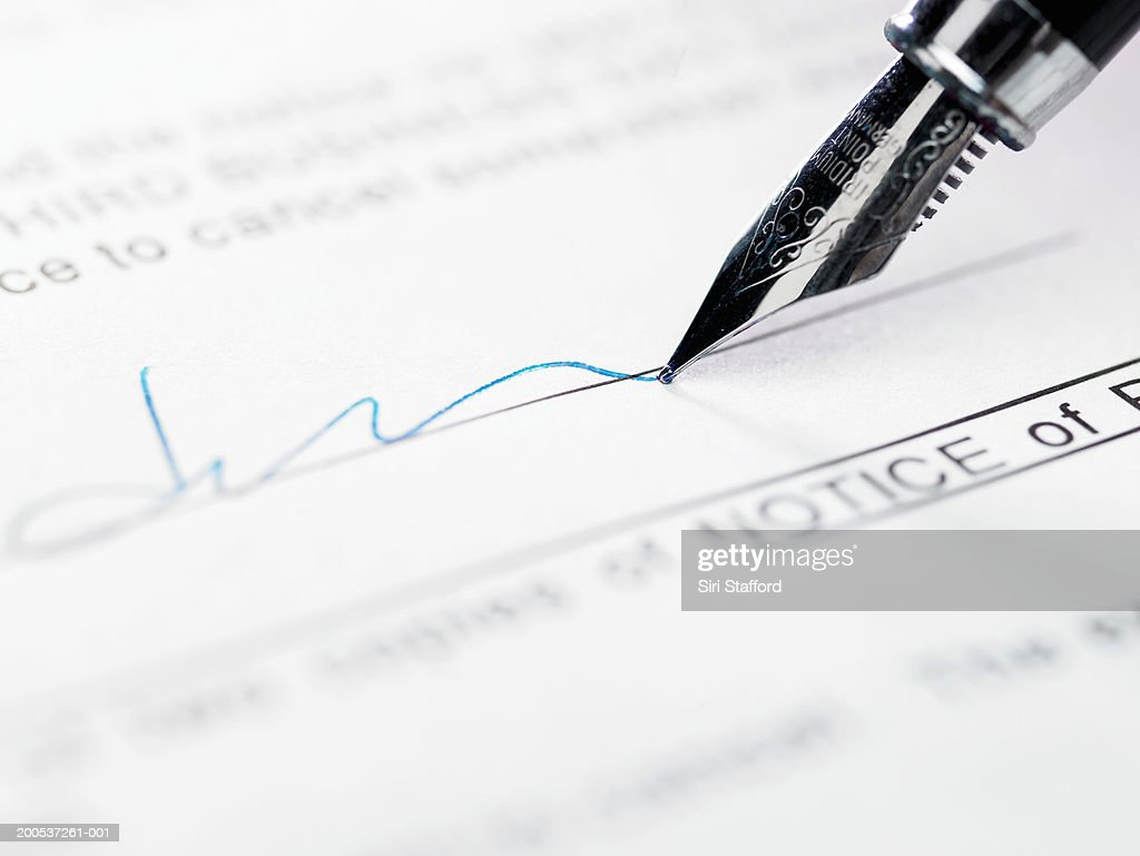 Man signing document, close-up