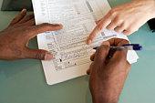 Man signing financial paperwork