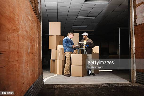 Man signing for delivery