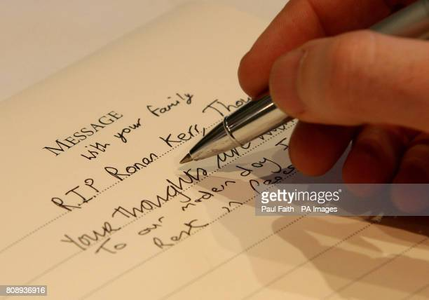 A man signs a book of condolence for Pc Ronan Kerr a Catholic policeman who died in Omagh on Saturday when a booby trap bomb detonated under his car...