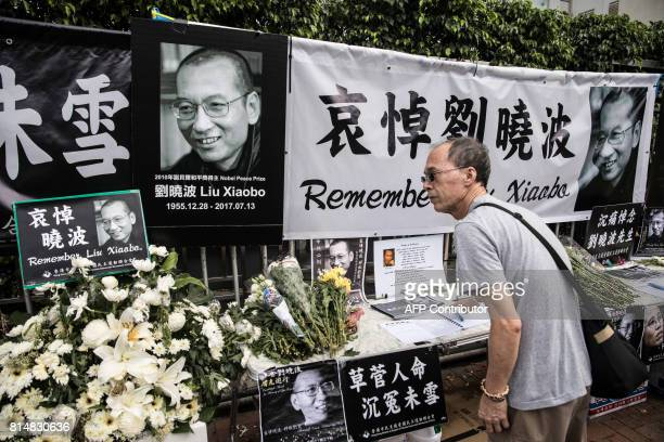 A man signs a condolence book at a makeshift memorial for the late Chinese Nobel laureate Liu Xiaobo outside the Chinese Liaison Office in Hong Kong...