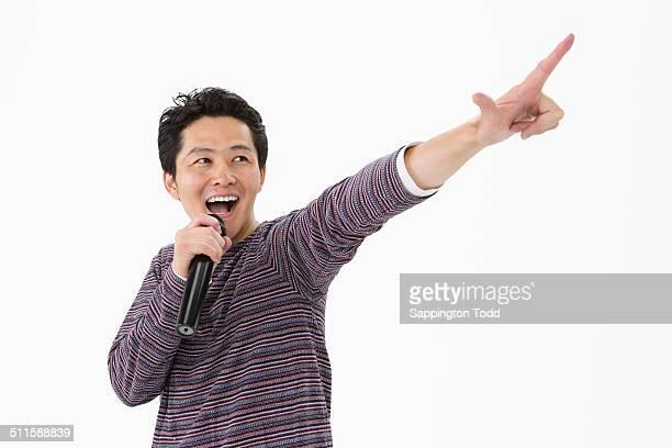 Man Singing In Microphone