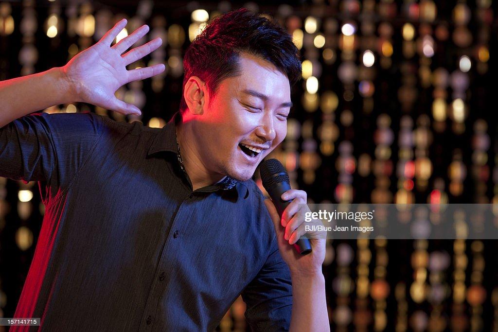 asian man karaoke